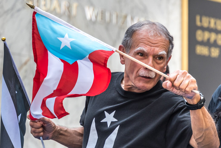 Puerto Rican independentist Oscar Lopez Rivera participates in the Puerto Rico Day Parade in New York on June 11, 2017, months after being released upon serving 35 years in prison.  Photo by Enrique Shore